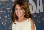 Sarah Palin, seen here, on Fox & Friends defending Josh Duggar and his actions. (AP Photo/Dennis System, File) / AP
